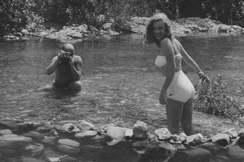 ONE-USE-ONLY-Wading-through-the-creek-Marilyn-looks-into-the-camera